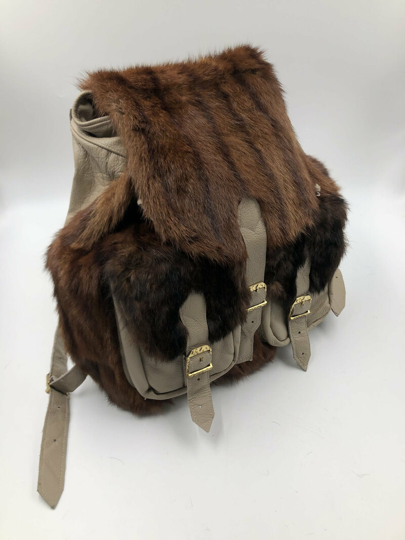Buy Beige real fur real leather backpack with pockets and belts.