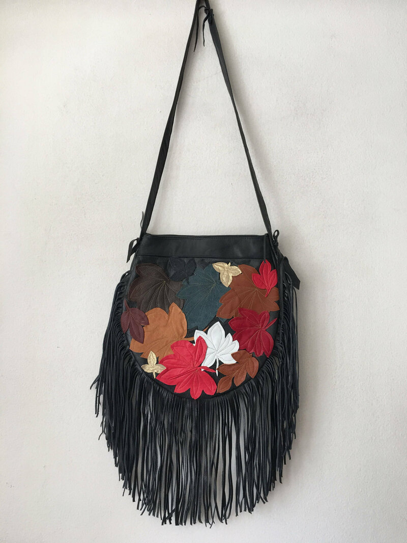 Buy Womens Leather Handmade Handbag Black color with a long handle with fringe and original details made in the USA.