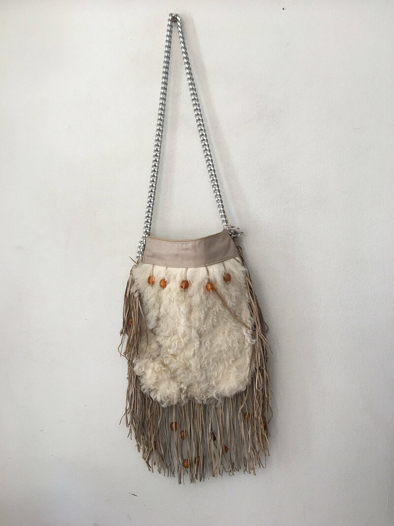 Buy Handmade women's white bag made of  leather and  goat's fur on a long handle,decorated with original detals and a fringe,made by the USA.