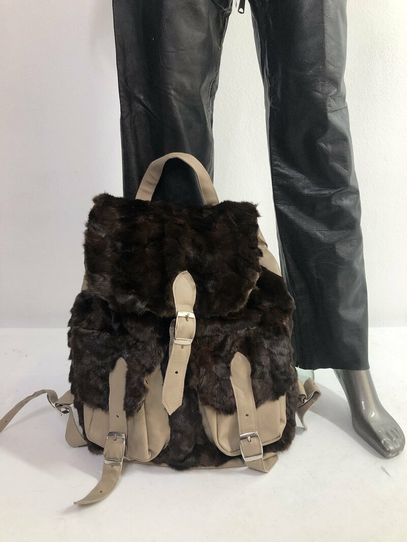Buy Brown real leather real fur backpack with belts with pockets.