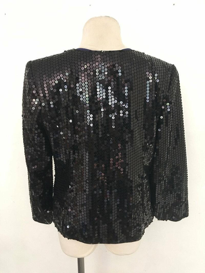 Black women's stylish jacket from soft textile with shiny sequins steep jacket vintage jacket short evening jacket black has size-medium.