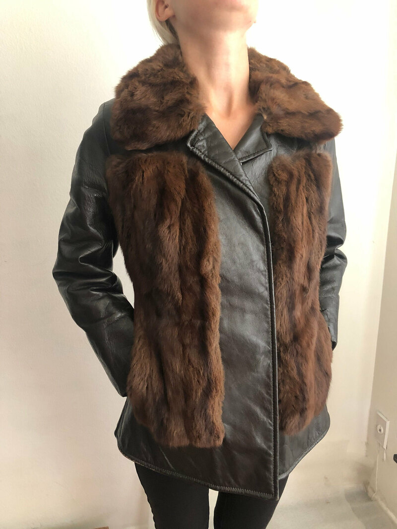 Buy Chic leather jacket with fur trim to cool weather; women's size  small.